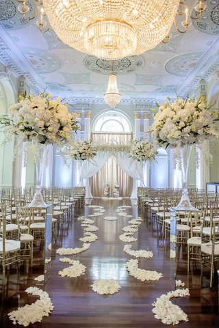 wood-floor-aisle-with-ivory-flower-petals-at-the-biltmore-ballrooms