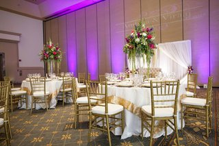 south-asian-wedding-inspiration-ivory-linens-with-thick-gold-border-gold-chiavari-chairs