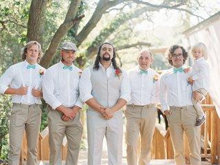 groomsmen-in-white-dress-shirts-turquoise-bow-ties-tan-vest-and-slacks-khaki-pants