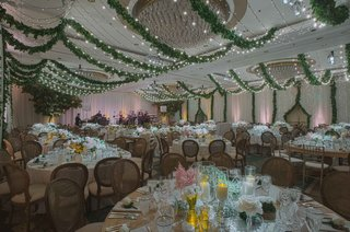 ballroom-wedding-with-garden-theme-wood-chairs-twinkle-lights-garlands-low-centerpieces