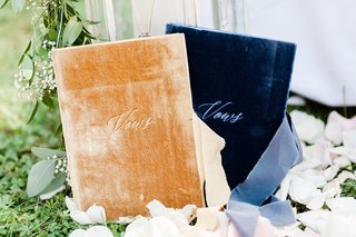 wedding-ceremony-vow-books-gold-and-navy-blue-velvet-vows-on-aisle-flower-petals