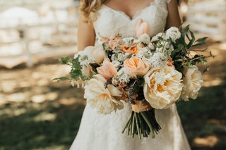 full-lush-bridal-bouquet-with-peach-peonies-and-ivory-flowers