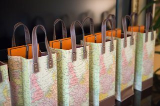 wedding-party-gifts-hermes-in-map-leather-travel-theme-gift-bags