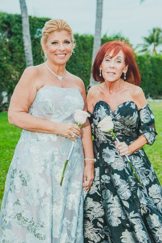 mother-of-the-bride-and-groom-in-complementary-black-white-and-silver-floral-gowns