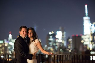 bride-in-short-sleeve-lace-wedding-dress-with-groom-outside-new-york-city-skyline-in-background