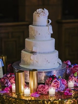 white-wedding-cake-with-lace-crystal-and-sugar-flower-details