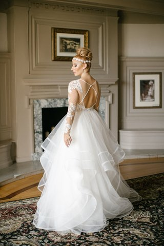 bride-in-hayley-paige-ruffled-skirt-ball-gown-lace-sleeves-illusion-keyhole-back