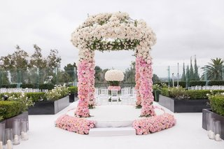 ceremony-arch-on-rooftop-at-the-london-west-hollywood-pink-and-white-roses-on-raised-stage-seating