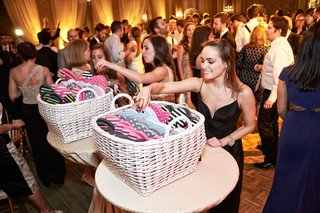 guests-selecting-from-basket-of-flip-flops-for-dancing-at-wedding