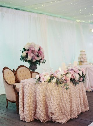 sweetheart-table-with-fabric-flower-linen-pink-and-white-flowers-and-antique-loveseat