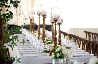 tented-reception-with-ornate-candleholders-lined-amid-white-pink-rose-table-runner