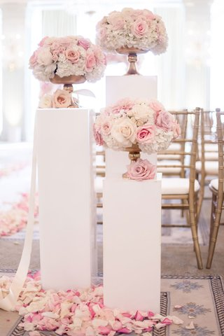 wedding-ceremony-entrance-white-risers-with-pink-white-rose-flowers-in-gold-footed-vases-flowers