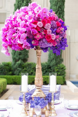 wedding-reception-centerpiece-of-magenta-orchids-light-purple-hot-pink-roses-purple-hydrangeas