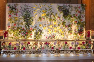 wedding-decoration-wall-covered-with-flowers-greenery-ice-sculpture-with-bright-flowers-frozen-insid