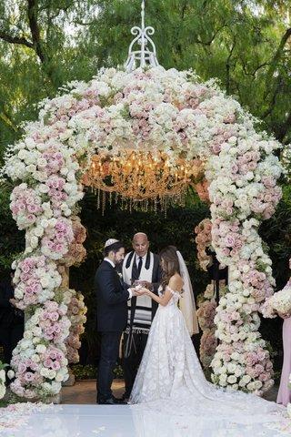 bride-in-off-shoulder-galia-lahav-wedding-dress-groom-in-tuxedo-officiant-chuppah-jewish-ceremony