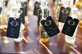 tequila-bottles-with-escort-cards-attached-to-them-for-destination-wedding-in-mexico