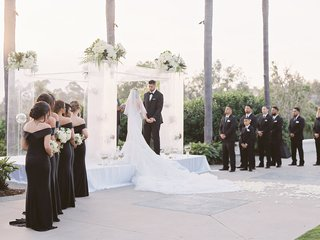 levine-toilolo-and-stephanie-ming-stage-wedding-ceremony-outdoor-bridesmaids-in-black-dresses