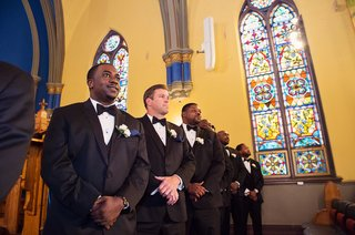 groomsmen-in-tuxedos-with-bow-ties-at-chicago-church-wedding-ceremony-with-nigerian-traditions