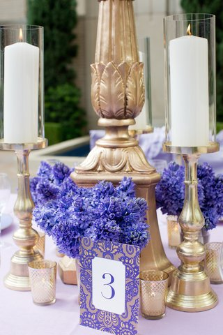 wedding-reception-table-with-table-number-of-purple-and-gold-damask-print-blue-hyacinths