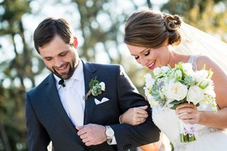 texas-bride-and-groom-link-arms-with-rustic-succulent-bouquet-and-succulent-boutonniere
