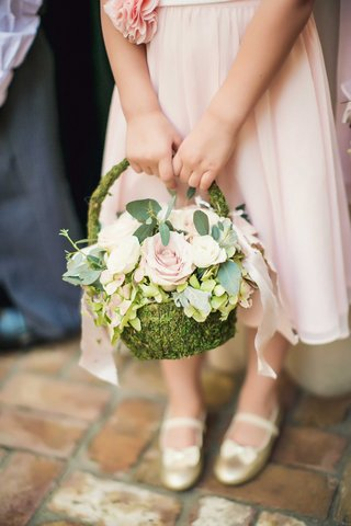 flower-girl-in-light-pink-dress-and-gold-ballet-flats-with-bows-holding-green-moss-basket-pink-rose