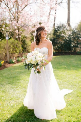 bride-in-reem-acra-wedding-dress-ivory-flower-bouquet-greenery-accents-medium-length-hairstyle-ideas