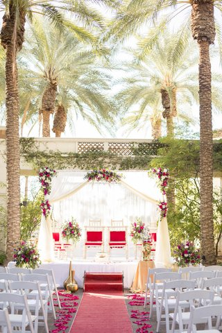 south-asian-wedding-inspiration-palm-trees-red-carpet-aisle-runner-mandap