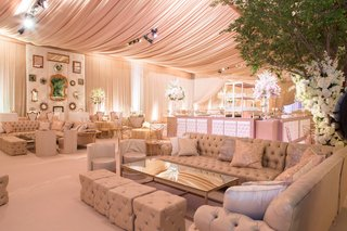 wedding-lounge-area-tufted-sofa-ottoman-trees-mirrors-texas-wedding-decor