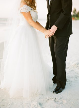 bride-in-a-monique-lhuillier-gown-with-tulle-skirt-and-lace-bodice-with-groom-in-black-tuxedo