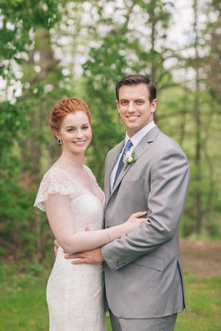 redhead-bride-in-suzanne-neville-lace-cap-sleeve-wedding-dress