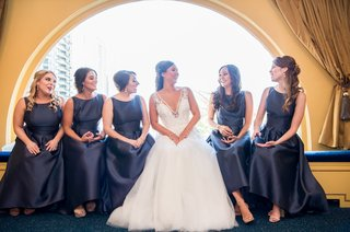 bride-in-hayley-paige-bridesmaids-in-navy-alfred-sung-high-low-dresses-with-boat-neckline