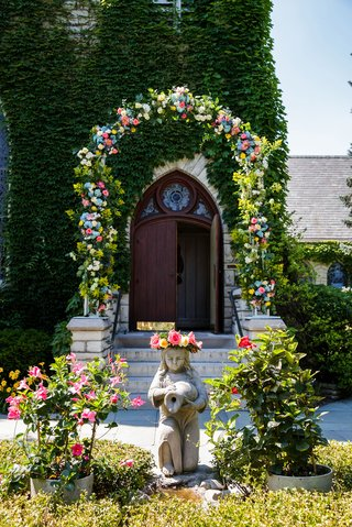 wedding-ceremony-with-flower-arch-outside-angel-flower-details