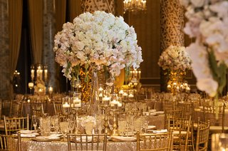 wedding-at-the-gold-coast-room-at-the-drake-hotel-gold-chiavari-chairs-large-tall-centerpieces