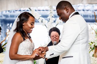 brooklyn-african-american-couple-at-wedding-ceremony-woman-officiant-orchid-flowers-white-strapless