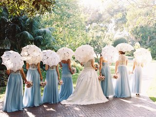 bride-and-bridesmaids-with-backs-turned-away-from-camera-white-lace-parasol-for-bridesmaids-guests