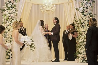 bride-in-vera-wang-ball-gown-groom-in-tuxedo-chuppah-with-chandelier