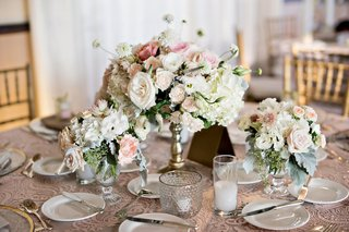 lower-gold-pedestal-arrangement-surrounded-by-candles-garden-roses-hydrangea-exotic-orchard-blooms