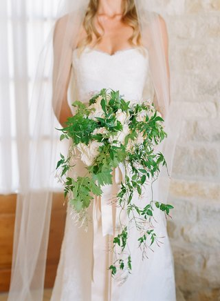 cascading-white-and-green-wedding-bouquet-with-vines-and-white-flowers