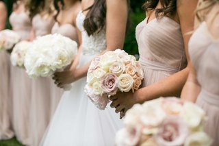 bridesmaids-holding-bouquets-of-pink-rose-cafe-au-lait-dahlia-peony-flowers-and-bride-with-peonies