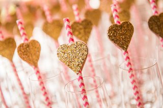 wedding-shower-with-pink-and-ivory-chevron-straws-glitter-hearts-in-champagne-flutes