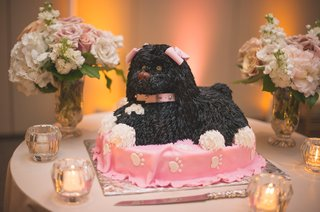 grooms-cake-in-the-shape-of-a-black-dog-with-pink-bows-on-a-pink-dog-bed-with-white-paw-prints