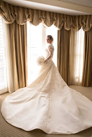 bride-in-marchesa-couture-wedding-dress-high-neck-illusion-long-sleeves-long-train-white-bouquet