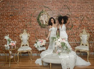 two-model-brides-in-pantora-bridal-wedding-dresses-in-vintage-inspired-lounge-area