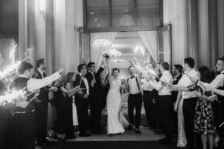 black-and-white-photo-of-bride-and-groom-grand-exit-sparklers-second-line
