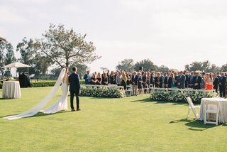 wedding-processional-at-the-lodge-at-torrey-pines-outdoor-wedding-ceremony-cathedral-veil