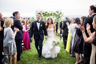 wedding-ceremony-recessional-bride-trumpet-gown-strapless-sweetheart-neckline-groom-in-tuxedo-hudson