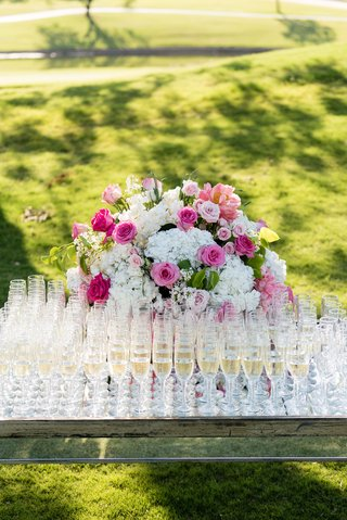 wedding-ceremony-outdoor-wedding-pink-rose-white-hydrangea-champagne-poured-into-flutes-glasses