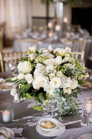 small-white-and-green-centerpieces-with-roses-tulips-eucalyptus