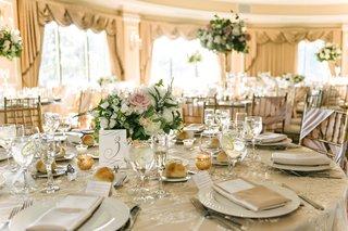 ballroom-wedding-oheka-castle-neutral-color-palette-low-flower-centerpiece-pink-rose-greenery