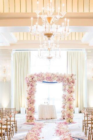wedding-ceremony-casa-del-mar-ivory-drapery-chandelier-pink-rose-petals-lining-aisle-chuppah-gold